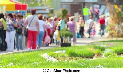 Crowd of people walking on main street of farmers' market