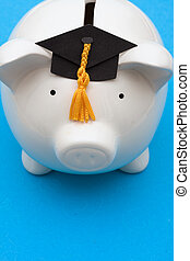 Saving for College - Piggy bank with graduation cap on blue...