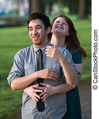 Playful romantic young couple