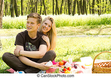 Cute looking boy with pretty girlfriend on picnic - Image of...