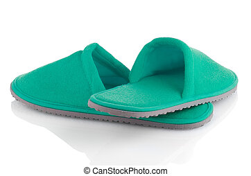 A pair of green slippers on a white background