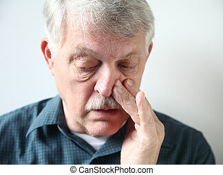 man with stuffy nose - mature man with congestion from a...