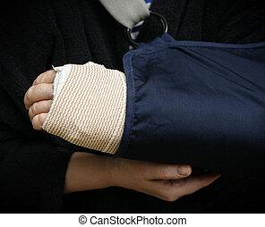 Broken arm - Woman holding her broken arm in cast