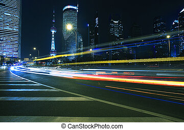 light trails on modern building background in shanghai china