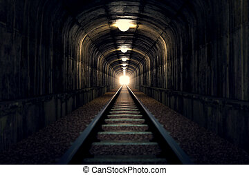 Light at the end of tunnel - A railroad tunnel with a light...