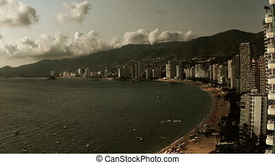timelapse of the huge bay of hotels stretching along the...