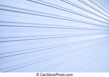 Illuminated metallic roller shutter door