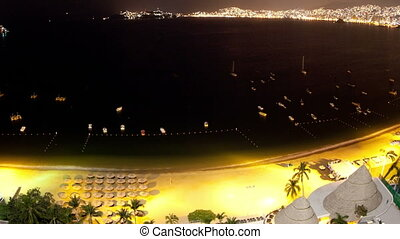 timelapse at night of the huge bay of hotels stretching...