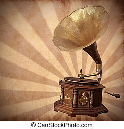 Old bronze gramophone on vintage background