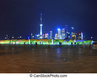 Shanghai Bund panoramic landmark skyline at Holiday night -...