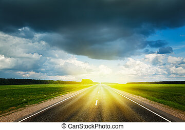 Road and stormy sky - Travel concept background - road and...