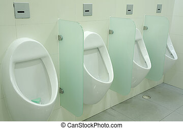 urinals at office - line of white porcelain urinals in...
