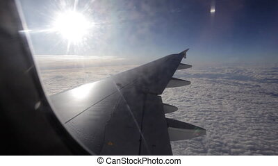 view of the wing of an airplane and the sky outside