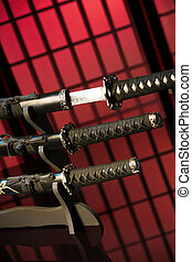 Drawn katana with other swords on red background in room