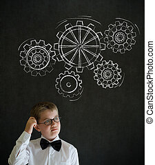 Scratching head thinking boy dressed up as business man with...