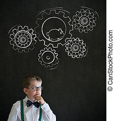 Thinking boy dressed as business man with chalk turning gear...