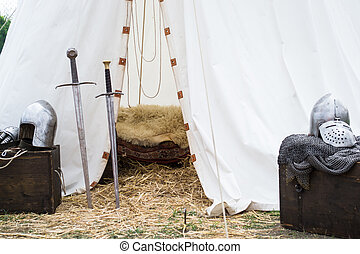 tent of medieval knights whith swords and peces of armour