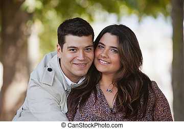 Portrait of a young couple smiling outdoor