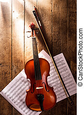 Violin and notes - Violin with bow and handdrawn notes under...
