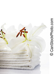 White spa towels with lily on white