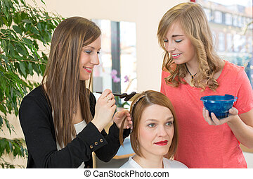 hairdresser dying hair of client - hairstylists or...
