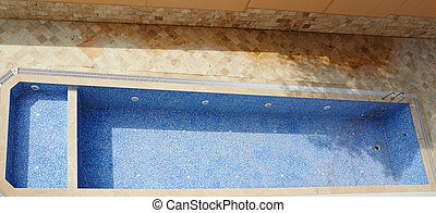 Empty swimming pool - Empty blue tiled swimming pool in a...