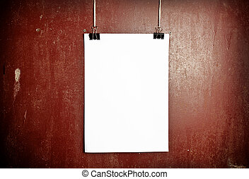 Blank white poster on a rope, metal background