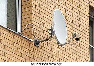 Sattelite antenna on a window - Antenna on wall near the...