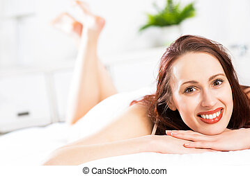 portrait of a young woman in the bedroom - portrait of a...