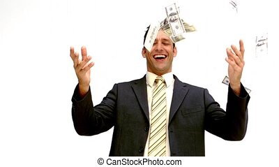 Businessman joyfully throwing his m