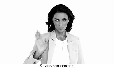 Businesswoman telling you to halt in black and white in slow...