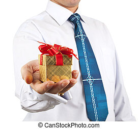 portrait of young business man handed a box with a gift in...