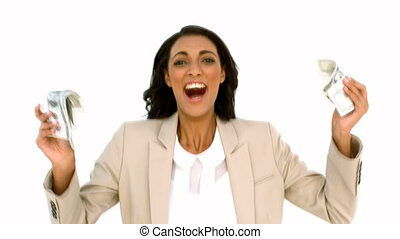 Cheerful businesswoman holding dollars and jumping in slow...