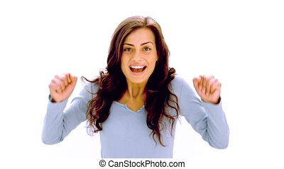 Pretty brunette cheering with joy on white background in...