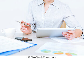 Modern business workflow - Relaxed businesswoman wearing...