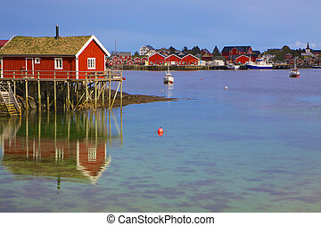 Norwegian fishing harbor - Typical red rorbu hut in fishing...