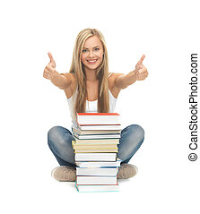 student with stack of books - picture of smiling student...