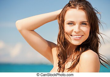 woman in bikini smiling - close up of beautiful woman in...