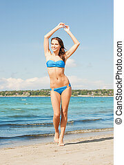 woman in bikini smiling - picture of beautiful woman in...
