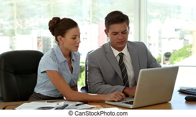 Business people working on laptop