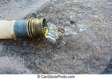 Fire fighting hose - Close up water flow out from end of...