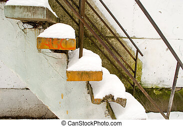 powdery snow cover the old cement stairs