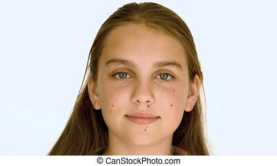 Girl smiling against white
