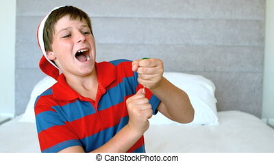 Happy boy using party popper in the