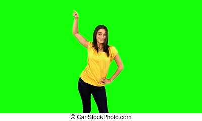 Woman doing a disco dance on green screen in slow motion