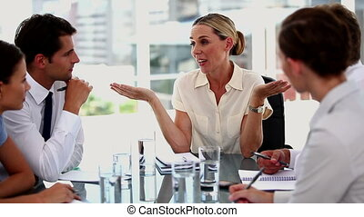 Businesswoman gesturing in front of