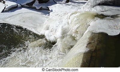 water fall edge ice - closeup of river cascade waterfall...