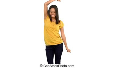 Woman dancing with arms raised on white background in slow...
