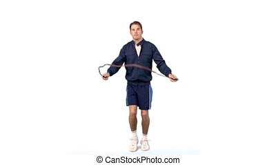 Young man training with a skipping rope in slow motion on...