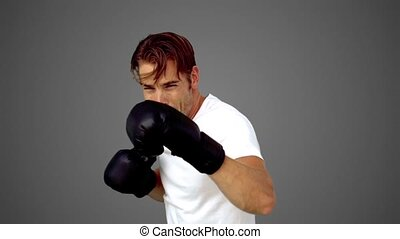 Sportsman boxing in front of the camera in slow motion on...